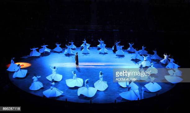 Whirling dervishes perform a Sema ritual during a ceremony one of many marking the 744th anniversary of the death of Mevlana Jalaluddin Rumi the...