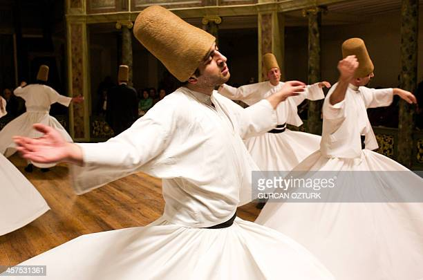 Whirling dervishes perform at the Galata Mevlevihane in Istanbul on December 18 2013 The dervishes are adepts of Sufism a mystical form of Islam that...