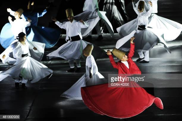 Whirling dervishes perform at the Maltepe Stadium in Istanbul on June 27 on the eve of Ramadan The dervishes are adepts of Sufism a mystical form of...