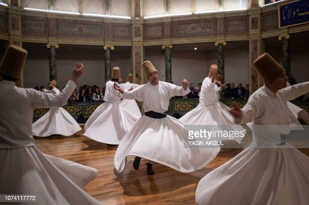 TOPSHOT Whirling dervishes perform during a ceremony marking the anniversary of the death of Jelaleddin Mevlana Rumi Sufi mystic poet and founder of...