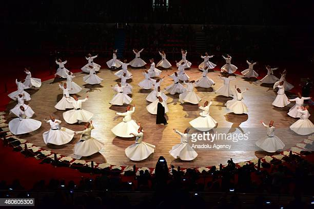 Whirling dervishes perform during a 'Sebi Arus' ceremony at Konya Metropolitan Municipality Sports and Congress Center to mark the 741st anniversary...