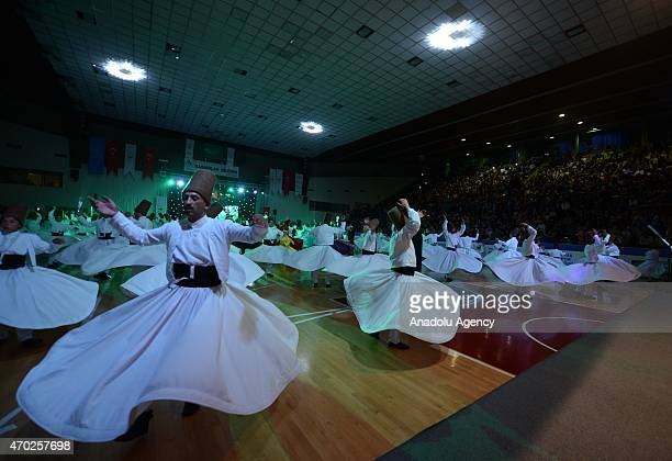 Whirling dervishes perform during the 'Holy Birth Week' celebrations marking Prophet Muhammad's birth in Bursa Turkey on April 18 2015 The Holy Birth...