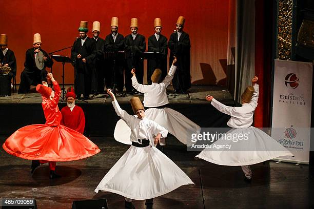 Whirling dervishes perform during the mesnevi program organized by Turkish officers in the capital Sarajevo Bosnia and Herzegovina on April 20 2014