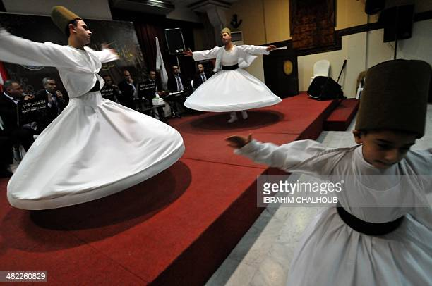 Whirling dervishes perform on the eve of birth anniversary of Islam's Prophet Mohammed in the northern Lebanese city of Tripoli on January 12 2014...