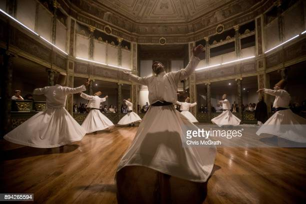 Whirling Dervishes take part in a Sema Prayer Ceremony marking the anniversary of the death of Mevlana Jalal alDin alRumi on December 17 2017 in...