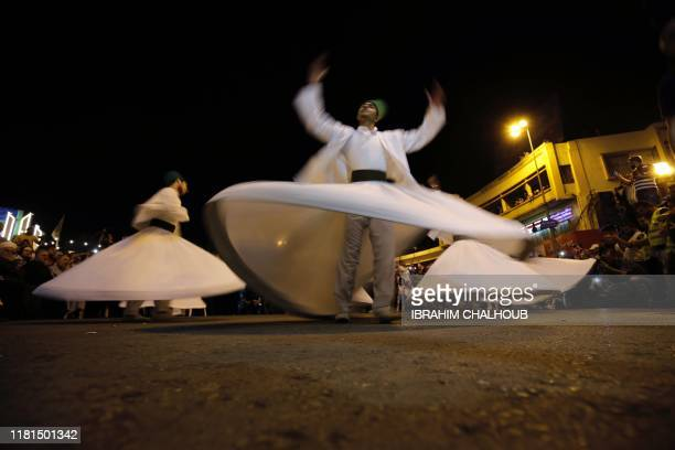 Whirling Derwishes perform in the streets of the northern Lebanese city of Tripoli celebrating Prophet Mohammed's birthday amid antigovernment...