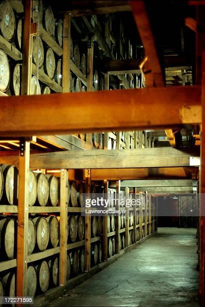 whiskey barrels in a distillery