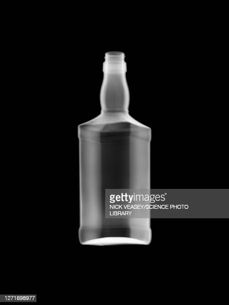 whiskey bottle, x-ray - bottle stock pictures, royalty-free photos & images
