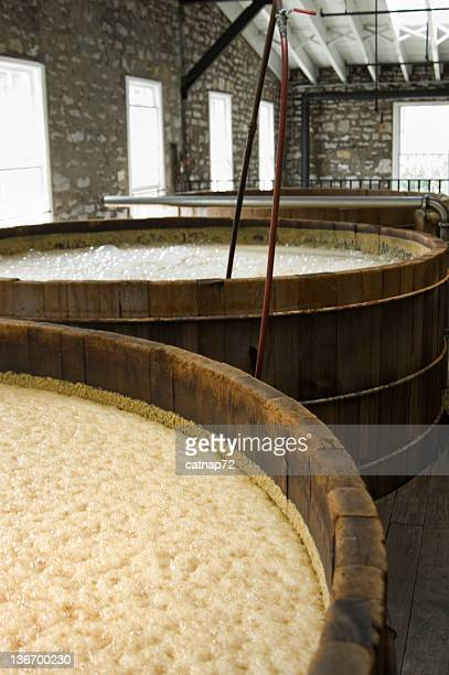 Whiskey Corn Mash Bubbling in Distillery Vats