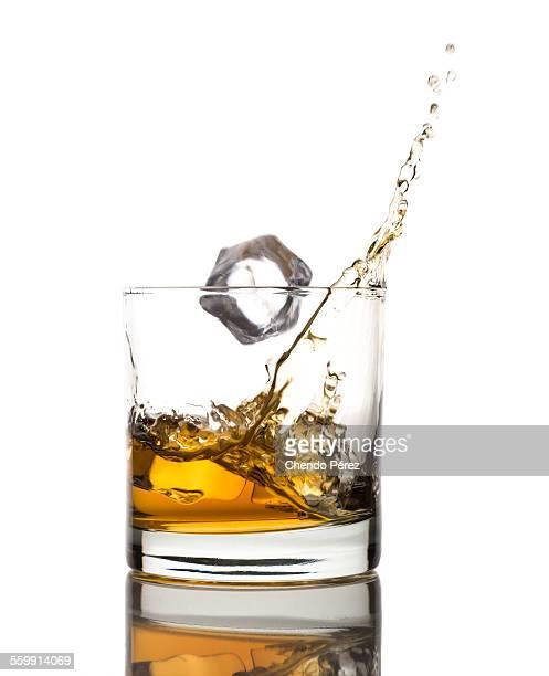 Whiskey ice splash