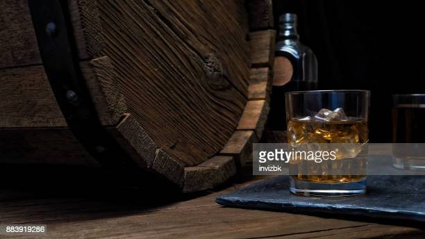whiskey on bar counter - whisky stock photos and pictures