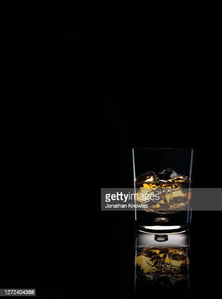 whiskey on the rocks - black background stock pictures, royalty-free photos & images
