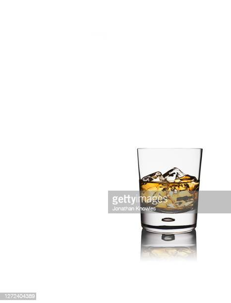 whiskey on the rocks - bourbon whiskey stock pictures, royalty-free photos & images