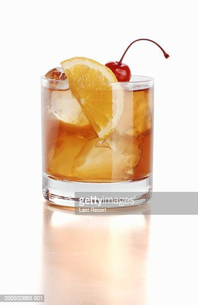 Whiskey sour with cherry and orange slice, close-up (still life)