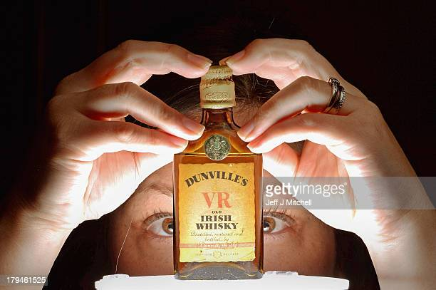 Whiskey specialist Lisa Mitchell at McTears auctioneers views lot 826 Dunville's VR miniature old Irish Whiskey expected to fetch between £40 £60 on...