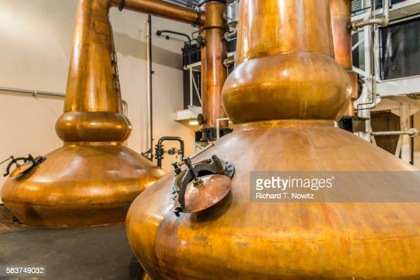whiskey still at glenglassaugh distillery - distillery stock pictures, royalty-free photos & images