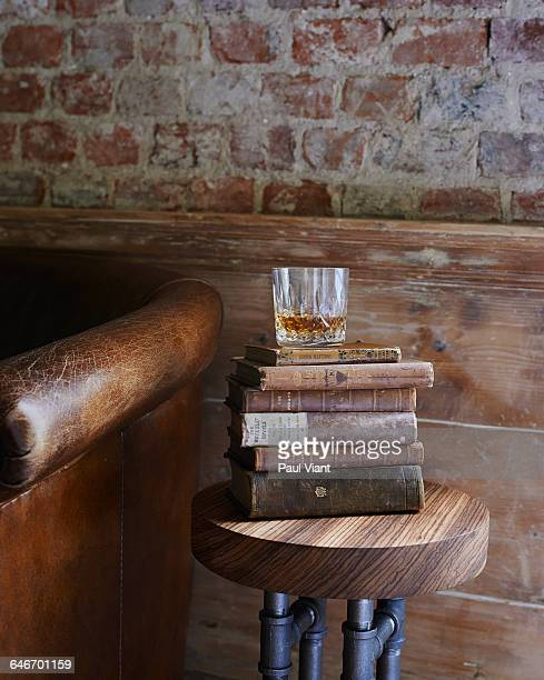 whiskey tumbler on antique books