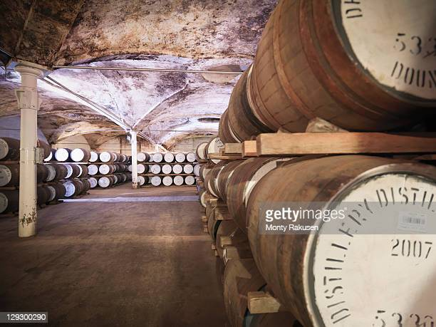 Whisky barrels ageing in distillery