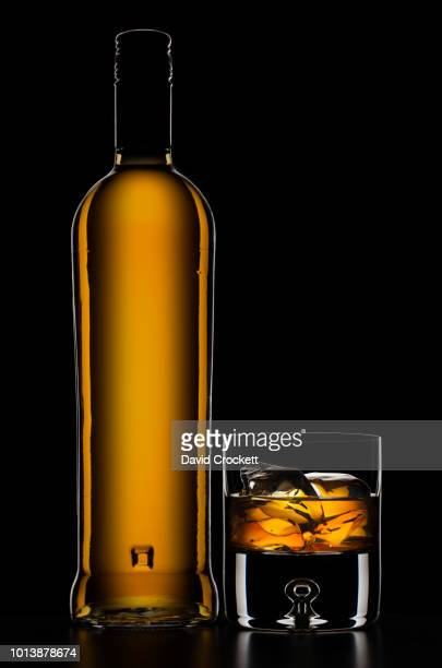 whisky bottle with glass - liquor bottles stock pictures, royalty-free photos & images