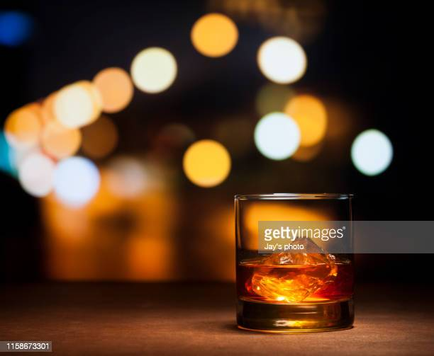 whisky in city abstract background - bourbon whisky foto e immagini stock
