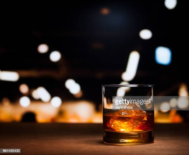 whisky in city abstract background - whisky stock photos and pictures