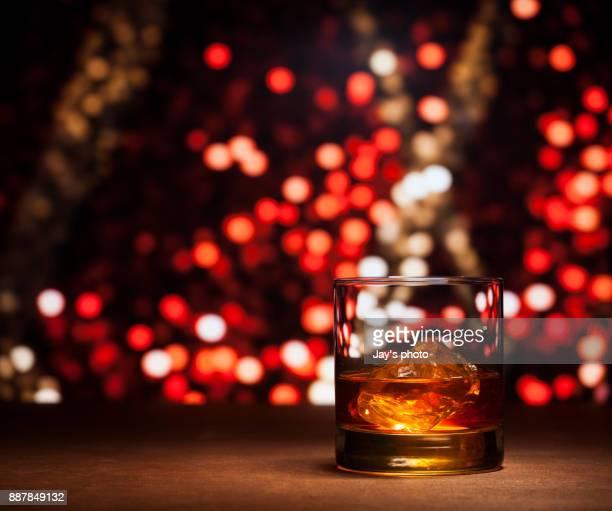 whisky in city background - bourbon whiskey stock-fotos und bilder