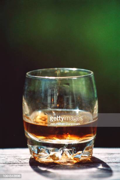 Whisky in glass on railing
