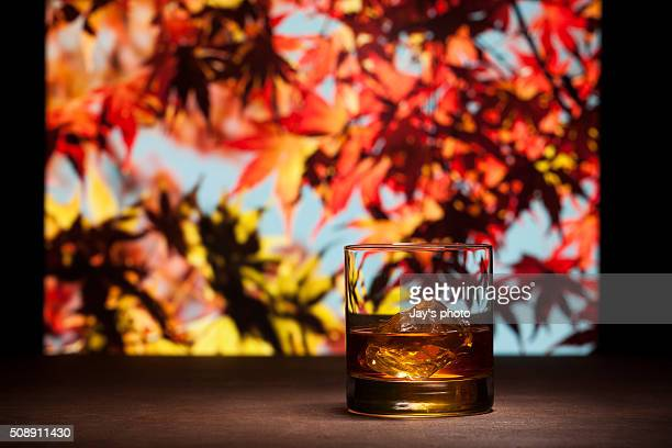 Whisky in maple leaf background
