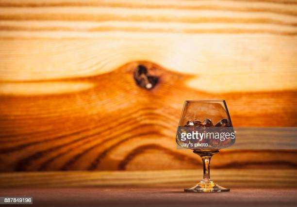 Whisky in wooden background