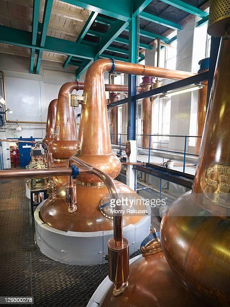 Whisky stills in a distillery