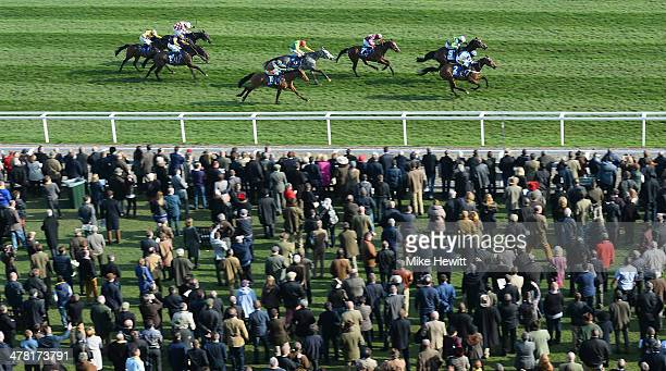 Whisper with Nico de Boinville on board win in a photo finish from Tony McCoy on Get Me Out Of Here in the Coral Cup during Ladies Day at Cheltenham...