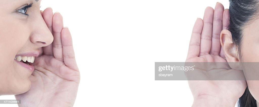 Whispering into her ear : Stock Photo