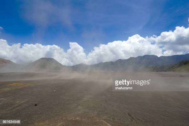 whispering sands in bromo tengger semeru national park, east java, indonesia. - shaifulzamri stock pictures, royalty-free photos & images