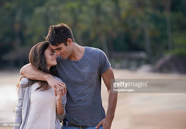whispering sweet nothings - young couples stock pictures, royalty-free photos & images