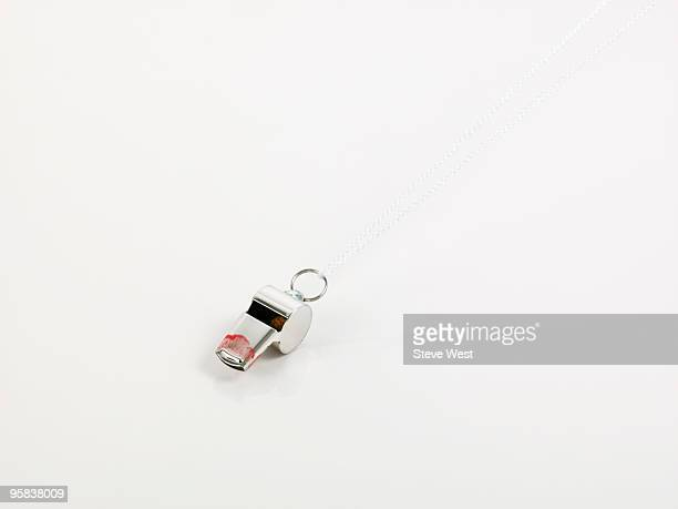 A whistle with lipstick stains