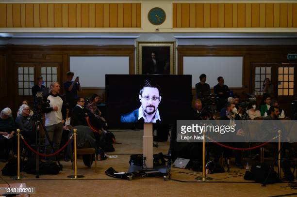 """Whistleblower Edward Snowden addresses the other speakers and audience through a live video link from Moscow, during """"The Belmarsh Tribunal"""", which..."""