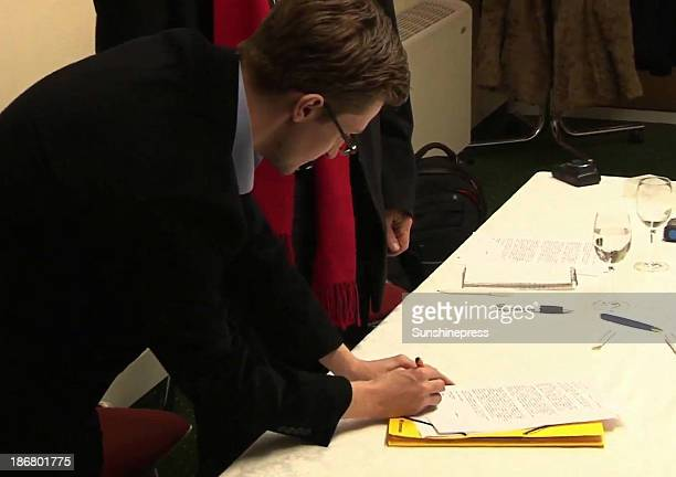 NSA whistleblower Edward Snowden signs a letter stating that he would be willing to be a witness in Germany should circumstances allow during a...