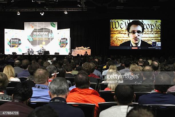 NSA whistleblower Edward Snowden speaks via videoconference at 'A Virtual Conversation with Edward Snowden' during the 2014 SXSW Music Film...