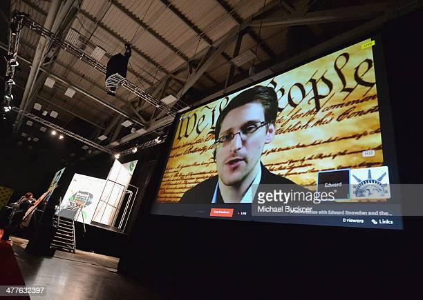 NSA whistleblower Edward Snowden speaks via videoconference at the 'Virtual Conversation With Edward Snowden' during the 2014 SXSW Music Film...