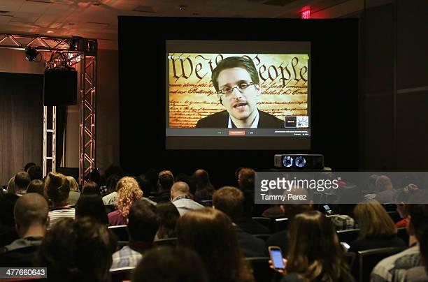 NSA whistleblower Edward Snowden speaks via videoconference at 'Why Didn't a Tech Journalist Break PRISM' during the 2014 SXSW Music Film Interactive...