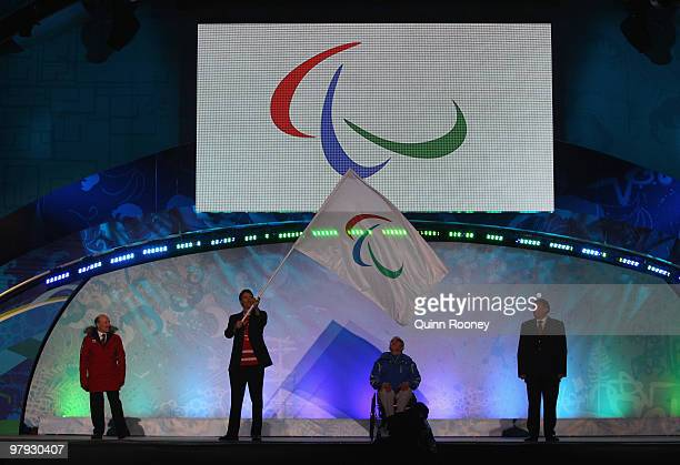Whistler Mayor Ken Melamed Vancouver Mayor Gregor Robertson IPC president Sir Philip Craven pass the flag to Mayor of Sochi Anatoly Pakhomov during...