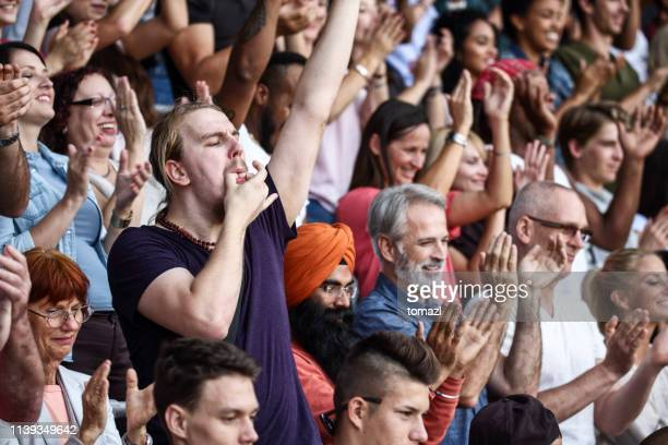 whistling on fingers at the match - sports event stock pictures, royalty-free photos & images