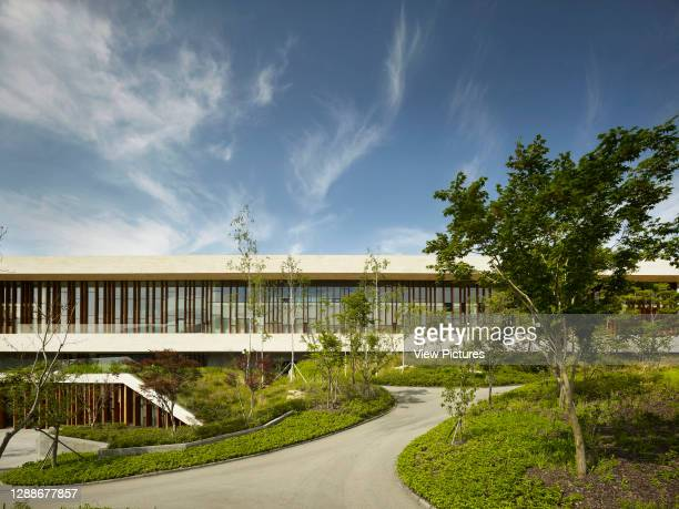 Whistling Rock Golf Clubhouse, Chuncheon, Korea, South. Architect: Mecanoo, 2012. Partial front elevation with walkway approach.