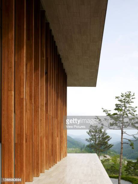 Whistling Rock Golf Clubhouse, Chuncheon, Korea, South. Architect: Mecanoo, 2012. Perspective of exterior timber frame with view towards mountains.