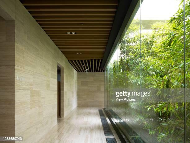 Whistling Rock Golf Clubhouse, Chuncheon, Korea, South. Architect: Mecanoo, 2012. Glazed corridor with view towards outdoor garden.