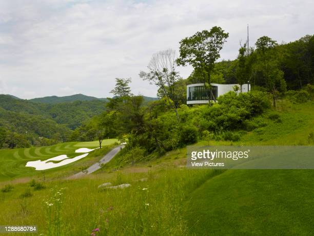 Whistling Rock Golf Clubhouse, Chuncheon, Korea, South. Architect: Mecanoo, 2012. Tea house on golf course slope.