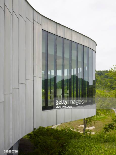 Whistling Rock Golf Clubhouse, Chuncheon, Korea, South. Architect: Mecanoo, 2012. Detail of curved and cantilever tea house facade.