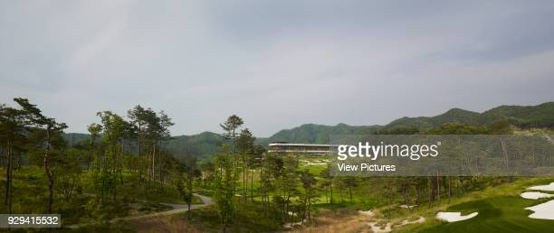 Whistling Rock Golf Clubhouse Chuncheon Korea South Architect Mecanoo 2012 Distant panoramic view across golf course towards clubhouse