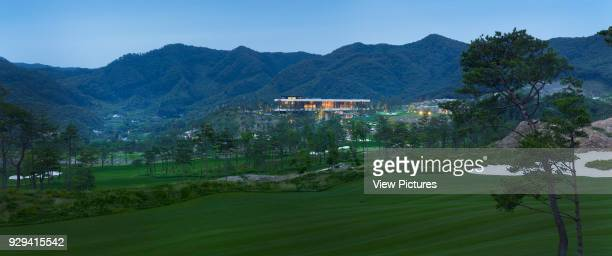 Whistling Rock Golf Clubhouse Chuncheon Korea South Architect Mecanoo 2012 Distant panoramic view across golf course towards clubhouse at dusk