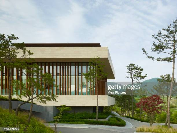 Whistling Rock Golf Clubhouse Chuncheon Korea South Architect Mecanoo 2012 Glass and timber framed facade and view to mountainerange